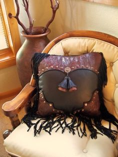 Western art pillow vintage style tooled by stargazermercantile, $265.00...............an idea for the leather stash I have