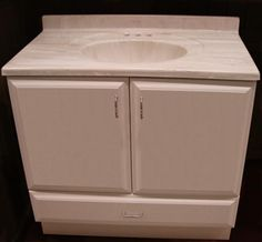 How to Build a Beautiful Bathroom Vanity Cabinet - free downloadable woodworking plans - basic cabinet building.