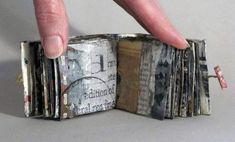 between pairs of lines by Linda Welch - A one-of-a-kind painted book by Portland artist Linda Welch. Her abstract, layered, mixed media books incorporate oil painting, collage, screen printing, found book pages and wax. This book includes collaged dress pattern papers.