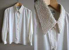 white blouse with a pearl collar.