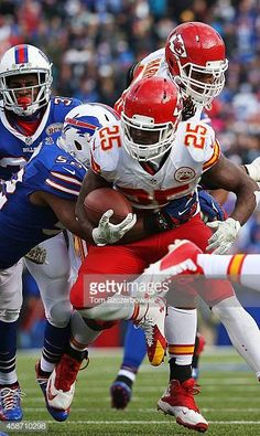 Jamaal Charles of the Kansas City Chiefs breaks a tackle by Preston Brown of the Buffalo Bills and scores a touchdown during the second half at Ralph. American Football League, Kansas City Chiefs Football, National Football League, Nfl Football, Football Players, College Football, New Nfl Helmets, Jamaal Charles, American Football
