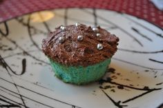 Blue cupcake with chocolate frosting