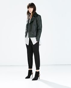 Faux leather jacket in emerald green. A perfect twist on your basic black.