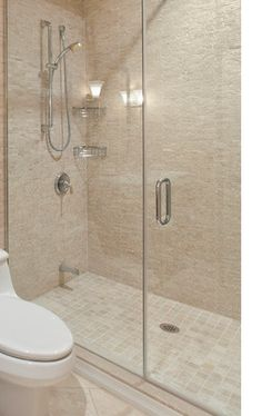 Shower with tile floor. Please go to http://merithomesinc.com/gallery/bathrooms/ for more information on Northwest Contemporary baths with modern finishes from Merit Homes, Inc., home builders in Redmond and Kirkland WA.