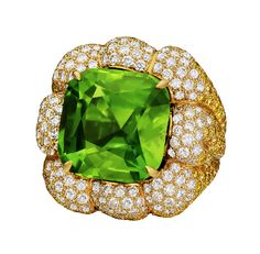 Margot McKinney.  PERIDOT 28.19CT RING WITH A HANDCRAFTED SETTING OF WHITE (3.87CT) AND YELLOW (5.02CT) DIAMONDS