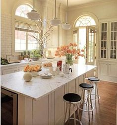 white kitchen with light counter tops, love the faucet -probably because it isn't a farmstyle, in a white kitchen. :)
