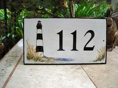 Shop for on Etsy, the place to express your creativity through the buying and selling of handmade and vintage goods. Tile House Numbers, Address Plaque, Lighthouse, Hand Painted, Creative, Handmade, Etsy, Tiles, Home Decor