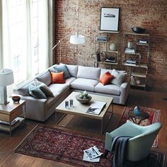 An Enchanting Living Room Design With Red Brick Wall Design With Modern Grey…