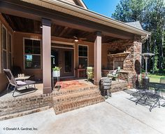 Back porch with fireplace! The Lisenby #1220. http://www.dongardner.com/house-plan/1220/the-lisenby. #RearPorch #Fireplace #OutdoorLiving