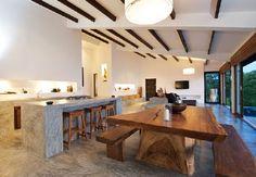 wooden dining table design near the kitchen in Casas Del Sol Villas
