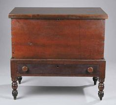 """A Tennessee Cherrywood Sugar Chest, mid-19th c., later rectangular top, divided interior, dovetailed construction, stand with drawer, turned legs.   Provenance: Acquired by the current owner from a Sumner County, Tennessee estate.  Reference: See """"A Short History of Tennessee Sugar Chests"""", The Magazine Antiques, September, 2003."""