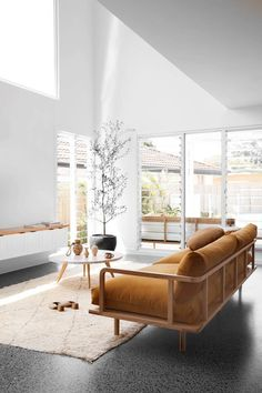 Warm, mid century modern furnishing offsets the industrial concrete floor in this elegant living space. Decor living room Ellie Bullen of Elsa's Wholesome Life's Gold Coast home Home Living Room, Living Room Decor, Living Spaces, Living Room Designs, Dining Room, Australian Homes, Concrete Floors, Dark Flooring, Flooring Ideas