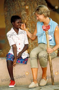 January 14, 1997: Diana, Princess of Wales speaks to 13-year-old amputee Sandra Tigica as she visits an orthopedic hospital in Angola as part of a Red Cross visit to highlight the injuries caused by landmines. Photo: Dave Chancellor-alpha-Globe Photos Inc 1997