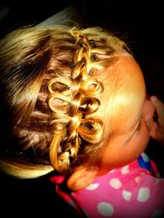 Little Dutch braid with little bows.