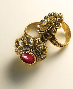 Rings- Floral rings with uncut diamonds and semi-precious colored gemstones in 22k yellow gold made with the repousse technique. (Semi-precious stones, uncut diamonds in 22k yellow gold)
