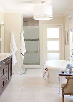 nice white bath... i love the shower enclosure and tub. [from house of turquoise: designed by tobi fairley]