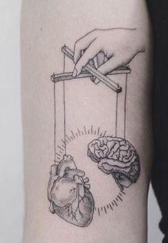 baddass puppet heart brain tattoo