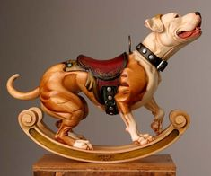 Tim Racer's gorgeous carousel/rocking horse dogs...I will seriously sweep his shop with my own hair for two years to get a custom Shiba and/or pit.