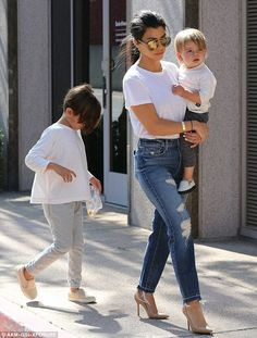 Single mom: Kourtney Kardashian ran errands in LA on Tuesday with sons Mason, six, and Reign, one. The boys' father is her ex Scott Disick who's currently partying at the Cannes Film Festival