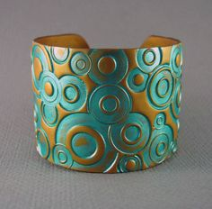 Gold Cuff Bracelet Polymer Clay hand Stamped Wide Cuff Teal Turquoise Cuff Art Jewelry. $18.00, via Etsy.