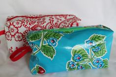 Oilcloth toiletries bags - great for keeping messes like toothpaste in