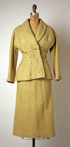 Suit Attributed to House of Dior (French, founded 1947) Designer: Attributed to Christian Dior (French, Granville 1905–1957 Montecatini) Date: 1950s Culture: French Medium: wool, silk, wood (?) Dimensions: Length at CB (a): 26 3/4 in. (67.9 cm) Length at CB (b): 31 in. (78.7 cm) Credit Line: Gift of Miriam Whitney Coletti, 1984