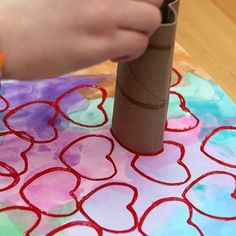 Upcycled Toilet Paper Roll Heart Stamper - From classroom activities to handmade Valentines to play at home kids will love to make these 18 super cute DIY craft projects. Each of these Valentine crafts is easy enough for most ages to enjoy making. #valentinesday #kidscrafts #diyvalentines #crafts #valentine #valentinecrafts #valentinesdaycrafts #craftsforkids