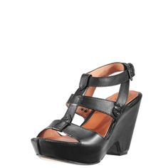 """The equestrian-inspired Coventry enjoys elevated status as an artisan-crafted sandal for the new Bohemian. Handcrafted from premium full-grain leather, with a hand-stained and burnished finish and edges, and a veg tan leather-lined footbed. Its equestrian-inspired look is embellished with Ariat's signature bit hardware with a leather-covered roller and hand-stitched western-style seam. The metallic heat-embossed and burnished logo features hand-tacked stitch detail.  The trendy 2"""" platform…"""