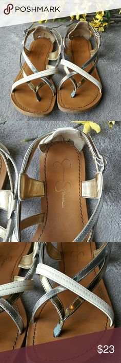 Jessica Simpson strappy metallic sandals Cute sandals from Jessica Simpson! Cream, silver, and gold straps. Some signs of wear on the straps. Jessica Simpson Shoes Sandals