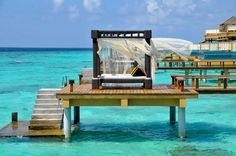 Angsana Velavaru ocean villas on the edge of a reef in the Maldives