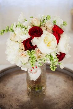 Classic red and white wedding bouquet {Credit: Design by Sage}