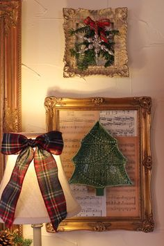 I switched out the Bordallo cabbage plates for Christmas trees, and added a sparkly snowflake in the smaller frames above. Some of the plaid flannel ribbon landed on our lamp shades, made into simple bows.