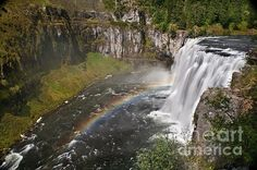 """Featured by at least 3 photography groups, """"Mesa Falls II"""" (by Robert Bales) is in the state of Idaho. Many of his beautiful photographs look like they could have been taken in Colorado. Catching the rainbow so clearly is amazing."""