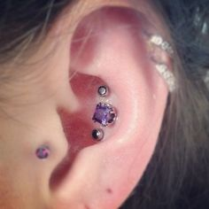 Girly, triple conch piercing.
