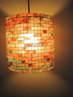Vilma Farrell from New York, specializes in creating beautiful lampshades from recycled coffee filters.  She dyes each coffee filter in a different color (red, green, blue and yellow) using acrylic paint water