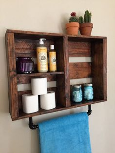 This beautiful handcrafted shelf and towel rack will dress up any bathroom. The wood is aged and stained to create an elegant yet rustic look.