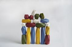 Gregory Buntain and Ian Collings. Fort Standard  This set of balancing blocks is made from salvaged hardwood and painted in white and primary colors. the faceted edges are interesting visually as well as functionally because they allow more surfaces and angles to balance with.
