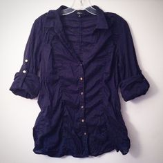 EXPRESS Convertible Button-Down (Large) Light and airy button-down blouse with buttons on sleeve so you can wear long-sleeved or convert to cropped sleeve. Navy blue with gold tone accents. Great pre-owned condition. 100% Cotton. Measurements available upon request. Comes from a clean, smoke-free home.   ____________________________________ Please ask any questions before purchasing. OFFERS ARE WELCOME. Thanks for visiting! Express Tops Button Down Shirts