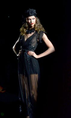 Karlie Kloss wearing a sheer black evening gown by Anna Sui. Image by Christopher Macsurak (CC-BY).