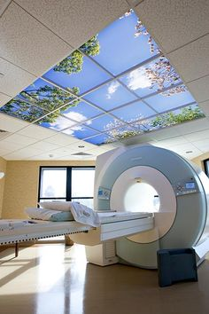 The large Sky Factory Luminous SkyCeiling™ in Allen Imaging Center's MRI suite creates a powerful illusion of real sky, even surrounded by floor-to-ceiling windows. Healthcare Design