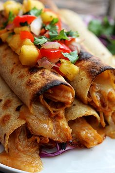 | Slow Cooker Hawaiian BBQ Chicken Taquitos |