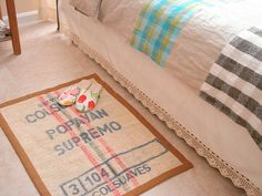 repurpose burlap coffee bean bags to make a couple of smaller rugs
