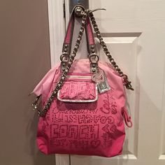 Rare Coach Poppy Bag This bag is gorgeous and rare. Has tons of accessories and fixtures on it including multiple keychains, zippers, and chain with leather woven through. The handles are metallic silver on one side and pink on the other. The lining is hot pink. This bag is nice and big!! Bought new from coach store for close to $600. Coach Bags Shoulder Bags