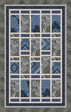 "Check out our FREE ""Night Sky Solstice"" quilt pattern using the collection, ""Starburst"" by Michele D'Amore for Contempo Studio. Designed by Janet Page Kessler. Finished size: 48"" x 76""."
