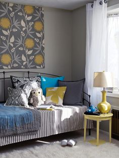 Gray walls with yellow and blue accent colors