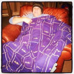 Crown Royal Bags I made into a blanket... A pallet and a case of whiskey bags to make this!