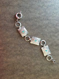 Vintage silver and turquoise belt has been made into a bracelet.