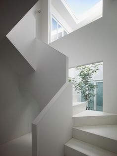 I like the large windows next to a white staircase, very bright. #minimal #white #staircase