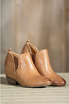 "Explore the vast urban miles in our smooth leather Felix. Hand burnished leather on the rounded toe and textured leather around the heel makes our classic wedge bootie supreme. A hidden 1¾"" wedge adds height, while dual elastic gore panels and leather pull tabs make easing in and out of these ankle"