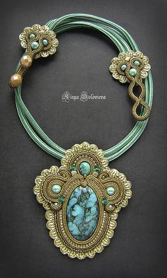 Beautiful pendant in vintage style . Made in technology sutazhnoy embroidery . In the center of jewelry funky beauty turquoise with pyrite, framed gold Japanese Delica 24 carats. Soutache for the job I am painted by hand so that was the effect of the old gold .